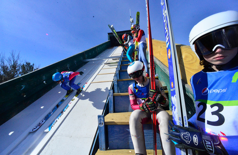 KRISTOPHER RADDER - BRATTLEBORO REFORMER<br /> Thomas Miller heads down the inrun while fellow jumpers watch during the trial run for the U.S. Cup / Pepsi Challenge at the Harris Hill Ski Jump, in Brattleboro, Vt., on Saturday, Feb. 17, 2018.