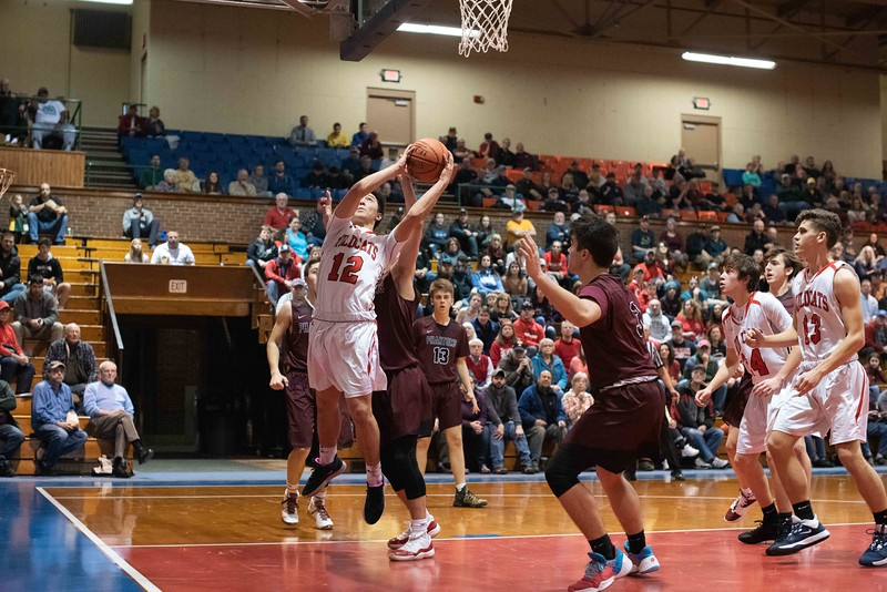 KELLY FLETCHER, REFORMER CORRESPONDENT -- Izaak Park goes up for a shot during the Wildcats' championshiop face off against Proctor Saturday in Barre.