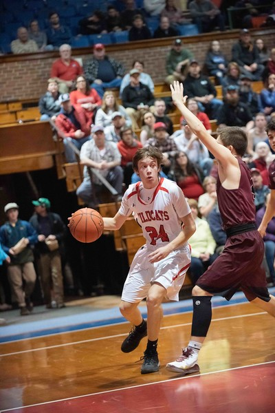 KELLY FLETCHER, REFORMER CORRESPONDENT -- Owen Grinold looks for options as he dribbles the ball down the court for Twin Valley during their championship contest against Proctor on Saturday in Barre.