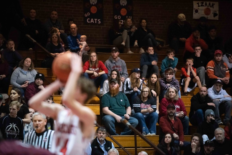 KELLY FLETCHER, REFORMER CORRESPONDENT -- fans look on as Twin Valley's Jack McHale takes a free throw during Saturday's championship game against Proctor in Barre.