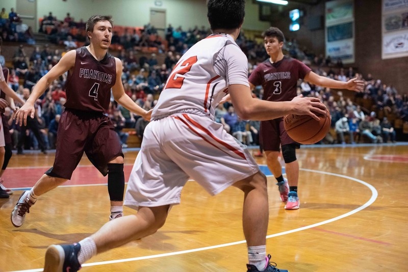 KELLY FLETCHER, REFORMER CORRESPONDENT -- Izaak Park looks for options among his opponents (#4, Joe Valerio and #3, Logan Starling) during Twin Valley's division 4 championship game against Proctor on Saturday in Barre.