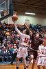 KELLY FLETCHER, REFORMER CORRESPONDENT -- Twin Valley's Colin McHale goes for a layup during Saturday's division 4 championship game against Proctor in Barre.  Also pictured is Proctor Guard, Conner McKearin.