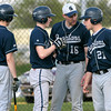 Springfield head coach Chris Shelly talks strategy during a time out with Max Vido, left, Tim Quigg and  Bobby Andris.<br /> Bob Raines 4/26/11