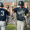 Springfield's David Langlois high-fives Doug Bauer after scoring on Devon Prep.<br /> Bob Raines 4/26/11