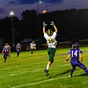 KRISTOPHER RADDER - BRATTLEBORO REFORMER<br /> Bellows Falls' Logan Cota is taken down by Burr and Burton's Connor Simonds during a football game at Bellows Falls Union High School on Friday, Sept. 15, 2017.