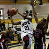 BBK_FC Const_0474  <br /> Faith Christian's Greg Boyd goes up for a shot past Constitution's Fajion Jones.