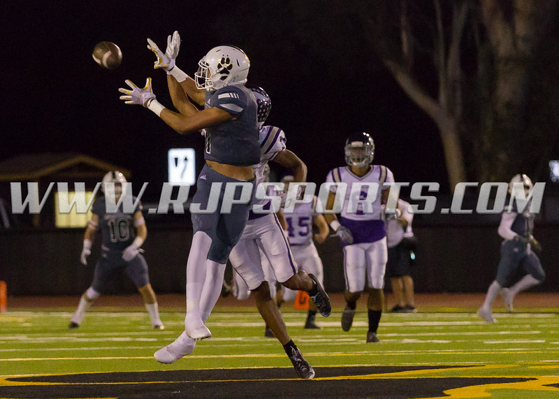 Calabasas Coyote Johnny Wilson (1, WR) in the air for the reception