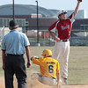 Fort Washington's P.J. Acierno steals second as Roslyn's Jordan Garnick leaps for a high throw.<br /> Bob Raines 7/11/11