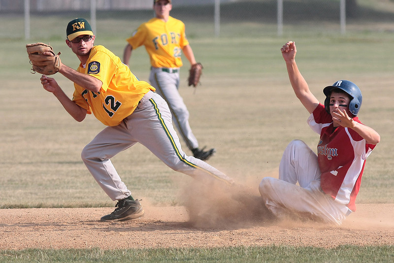 Roslyn's Kris Carr steals second as Fort Washington's Jared Zarwin takes a wide throw.<br /> Bob Raines 7/11/11