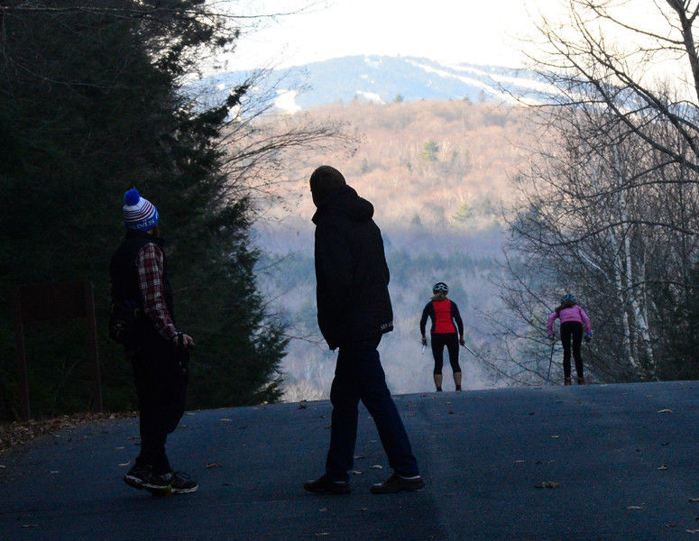 KRISTOPHER RADDER - BRATTLEBORO REFORMER<br /> Sverre Caldwell watches as members of his team ski past him.