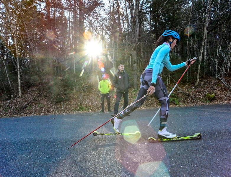 KRISTOPHER RADDER - BRATTLEBORO REFORMER<br /> Anna Lehmann, Windham, Vt., roller skis past Matt Boobar and Sverre Caldwell during a cross-country ski practice on Wednesday, Nov. 29, 2017.