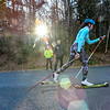KRISTOPHER RADDER - BRATTLEBORO REFORMER<br /> Anna Lehmann, Windham, Vt., roller skis past Matt Boobar and Sverre Caldwell during a cross-country ski practice on Wednesday, Nov. 29, 2017.