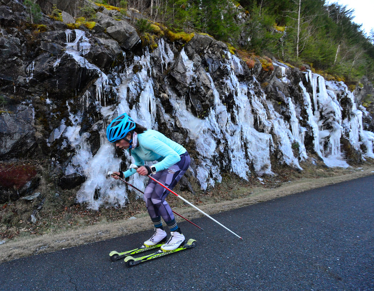 KRISTOPHER RADDER - BRATTLEBORO REFORMER<br /> Anna Lehmann, Windham, Vt., roller skis past a wall of ice on Ball Mountain Lane during a cross-country ski practice on Wednesday, Nov. 29, 2017.