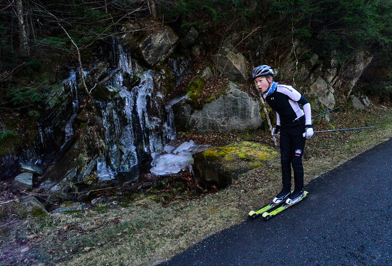KRISTOPHER RADDER - BRATTLEBORO REFORMER<br /> Mathias Boudreaux-Golfman, of Londonderry, Vt., roller skis past a wall of ice on Ball Mountain Lane during a cross-country ski practice on Wednesday, Nov. 29, 2017.