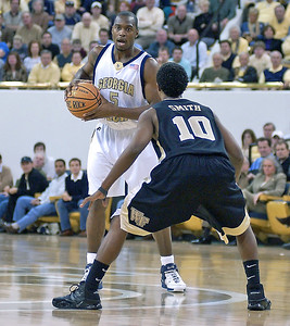 Mario calling out to one of his team mates to set up a pass that would lead the jackets to another basket.