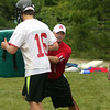 Coach Luke Harris demonstrates a rushing technique at Germantown Academy football camp.<br /> Bob Raines 8/23/10