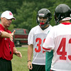 Coach Luke Harris explains a rushing technique at Germantown Academy football camp.<br /> Bob Raines 8/23/10
