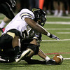 Glen Mills' George Walker fumbles giving Archbishop Wood possession deep in the Glen Mills zone.<br /> Bob Raines 10/1/11