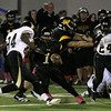 Wood's Desmond Peoples reverses direction eluding a tackle by Glem Mill's Tyrell Davis-Sanford.<br /> Bob Raines 9.30.11