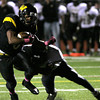 Archbishop Wood's Brandon Peoples takes a Glen Mills hit but continues into the endzone.<br /> Bob Raines 10/1/11