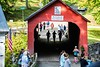 Participants in the Green River Marathon cross the Green River Bridge in Guilford during the race on Sunday, September 1; KELLY FLETCHER, REFORMER CORRESPONDENT