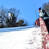 KRISTOPHER RADDER - BRATTLEBORO REFORMER<br /> Dennis Sawyer watches ski jumpers practice on Friday, Feb. 17, 2017 for this weekend's ski competition at the Harris Hill Ski Jump in Brattleboro, Vt.