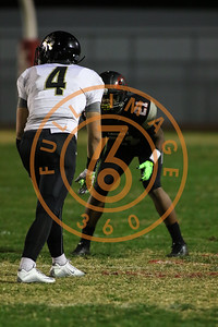 Nov 20 : Calabasas Coyotes rb, olb Erik Hillman (4) guarded by Lawndale Cardinals' Bryant Perkinson (C) (21)  Game action in quarterfinals of CIFSS Playoffs with Calabasas vs. Lawndale at Lawndale High School in Lawndale, Ca (Photo by Jevone Moore/Full Image 360)