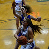 KRISTOPHER RADDER — BRATTLEBORO REFORMER<br /> Hinsdale's Delaney Wilcox takes an attempt while being covered by Concord Christian Academy's Hannah Vacco during a girls' basketball game at Hinsdale High School on Monday, Jan. 7, 2019.