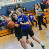 KRISTOPHER RADDER — BRATTLEBORO REFORMER<br /> Hinsdale's Ciera Youmell tries to get past Conant's Holly Tom during a unified basketball game at Hinsdale Middle High School on Monday, Feb. 4, 2019.