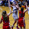 KRISTOPHER RADDER - BRATTLEBORO REFORMER<br /> Hinsdale's Skyler LeClair leaps over Mascenic's defense to score a basket during a girls' varsity basketball game at Hinsdale High School on Tuesday, Jan. 10, 2017.