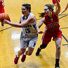 KRISTOPHER RADDER - BRATTLEBORO REFORMER<br /> Hinsdale's Skyler LeClair passes the ball to an open player while being covered by Mascenic's Megan Brand during a girls' varsity basketball game at Hinsdale High School on Tuesday, Jan. 10, 2017.