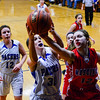 KRISTOPHER RADDER - BRATTLEBORO REFORMER<br /> Hinsdale's Angelina Nardilill reaches for the ball for an offensive rebound while being covered by Mascenic's Megan Brand during a girls' varsity basketball game at Hinsdale High School on Tuesday, Jan. 10, 2017.