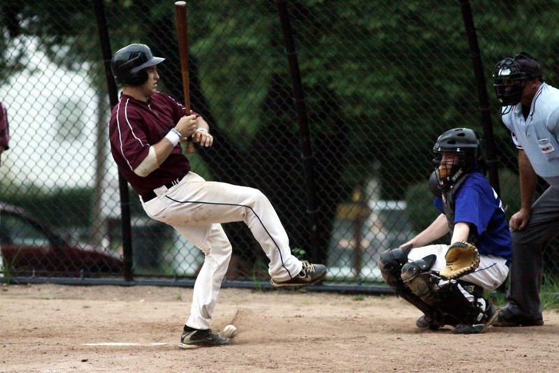 Horsham's Matt Schoettle gets hit spinning away from a pitch.
