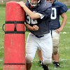 Jenkintown's James Thomas brushes past a blocking bag during a rushing drill.