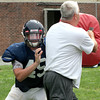 Jenkintown's Jim McKernan gets past Coach David Seitz during a rushing drill.