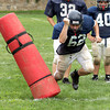 Jenkintown's Cooper Beaupre brushes aside a blocking bag during a rushing drill.