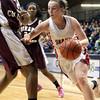 Jenkintown's Emma Dorshimer gets inside Girard College's G'mrice Davis as she drives for the basket.