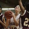 Jenkintown's Ruby Westkaemper goes up for a shot past Girard College's Desiree Rambert.