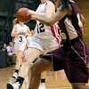 Jenkintown's Emma Dorshimerdrives for the basket as Girard College's Jodi Marshall tries to cut her off.