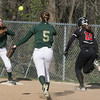 SB_LC HH_1199<br /> Lansdale Catholic pitcher Mary Kate Scott underhands the ball to Lexi Mayo at first base to force Hatboro Horsham's Maggie Shaffer.<br /> Bob Raines 3.26.12