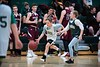 Spencer Claussen takes the ball down the court during the junior pro game with Abigail Emerson in pursuit and Black River varsity members looking on.  KELLY FLETCHER, REFORMER CORRESPONDENT