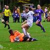 KRISTOPHER RADDER — BRATTLEBORO REFORMER<br /> Bellows Falls' MacKenna Milbauer secures the ball before Leland & Gray's Ansley Henderson soccer during a girls soccer match at Bellows Falls Union High School on Wednesday, Oct. 9, 2019.