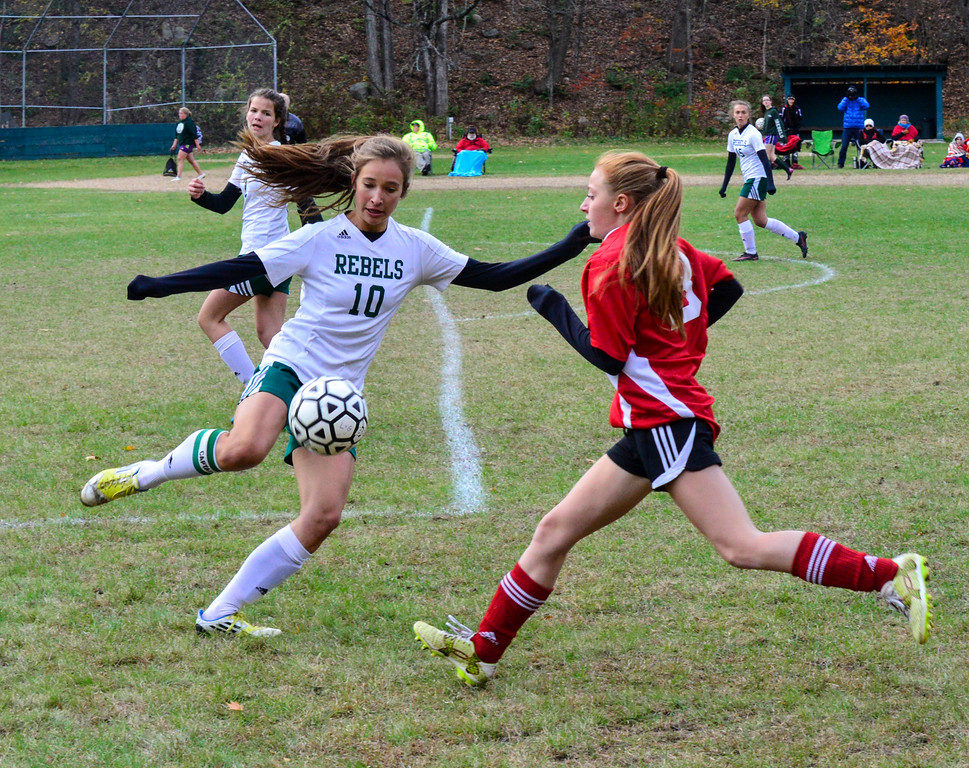 . Leland & Gray\'s Emma Bourne boots the ball down the field during a playoff game at Leland & Gray Union High School on Tuesday, Oct. 25, 2016.  Kristopher Radder / Reformer Staff