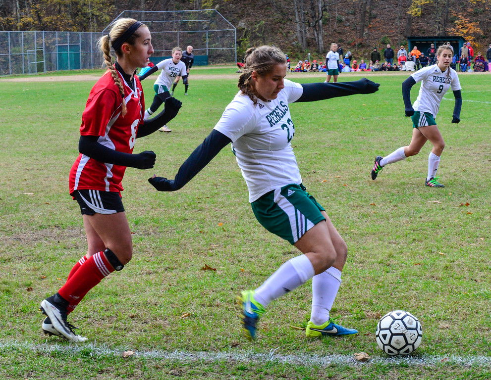 . Leland & Gray\'s Rachel Borgesen kicks the ball away from Twin Valley\'s Caitlin Hunt during a playoff game at Leland & Gray Union High School on Tuesday, Oct. 25, 2016.  Kristopher Radder / Reformer Staff