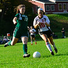 KRISTOPHER RADDER — BRATTLEBORO REFORMER<br /> Leland & Gray's Erin Cutts kicks the ball away from Twin Valley's Sadie Boyd during a soccer match on Tuesday, Oct. 9, 2018.