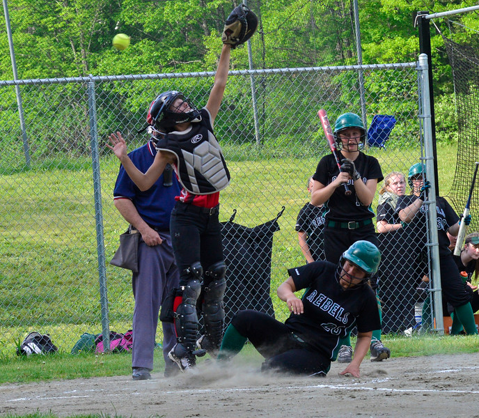 Leland & Gray's Rachel Borgesen slides into home as the ball over Twin Valley's catcher Karlee Walkowiak during a softball game on Thursday, May, 26, that was a continuation of a game started  on Friday, May 13, 2016. Leland & Gray would beat Twin Valley 19-0. Kristopher Radder / Reformer Staff
