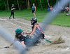 Twin Valley's catcher Karlee Walkowiak applies the tag onto Leland & Gray's Caroline Tietz while she tried to slide into home during a softball game on Thursday, May, 26, that was a continuation of a game started  on Friday, May 13, 2016. Leland & Gray would beat Twin Valley 19-0. Kristopher Radder / Reformer Staff