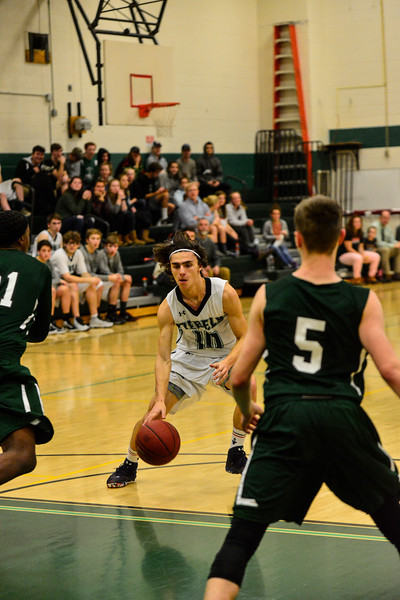 KRISTOPHER RADDER - BRATTLEBORO REFORMER<br /> Leland & Gray players take on Springfield during a varsity boys' basketball game at Leland & Gray Union Middle and High School on Thursday, Jan. 11, 2018.