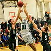 KRISTOPHER RADDER - BRATTLEBORO REFORMER<br /> Leland & Gray's Dakota Fillion goes for a layup while being covered by Springfield's Noah Zierfus during the varsity boys' basketball game at Leland & Gray Union Middle and High School on Thursday, Jan. 11, 2018.