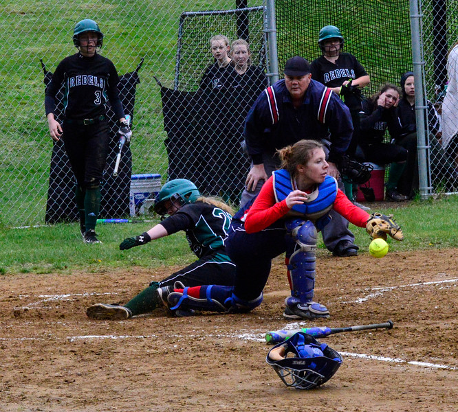 KRISTOPHER RADDER - BRATTLEBORO REFORMER<br /> Leland & Gray's Jessie Stockwell slides into home plate while Hartford's Jasmyn Rogers could not hold onto the ball during a softball game at Leland & Gray Union Middle and High School on Tuesday, May 9, 2017.